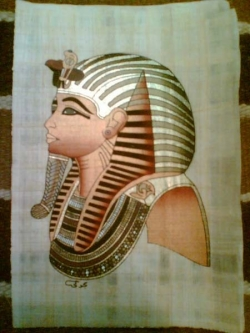 Golden mask ot King Tutankhamen painted papyrus